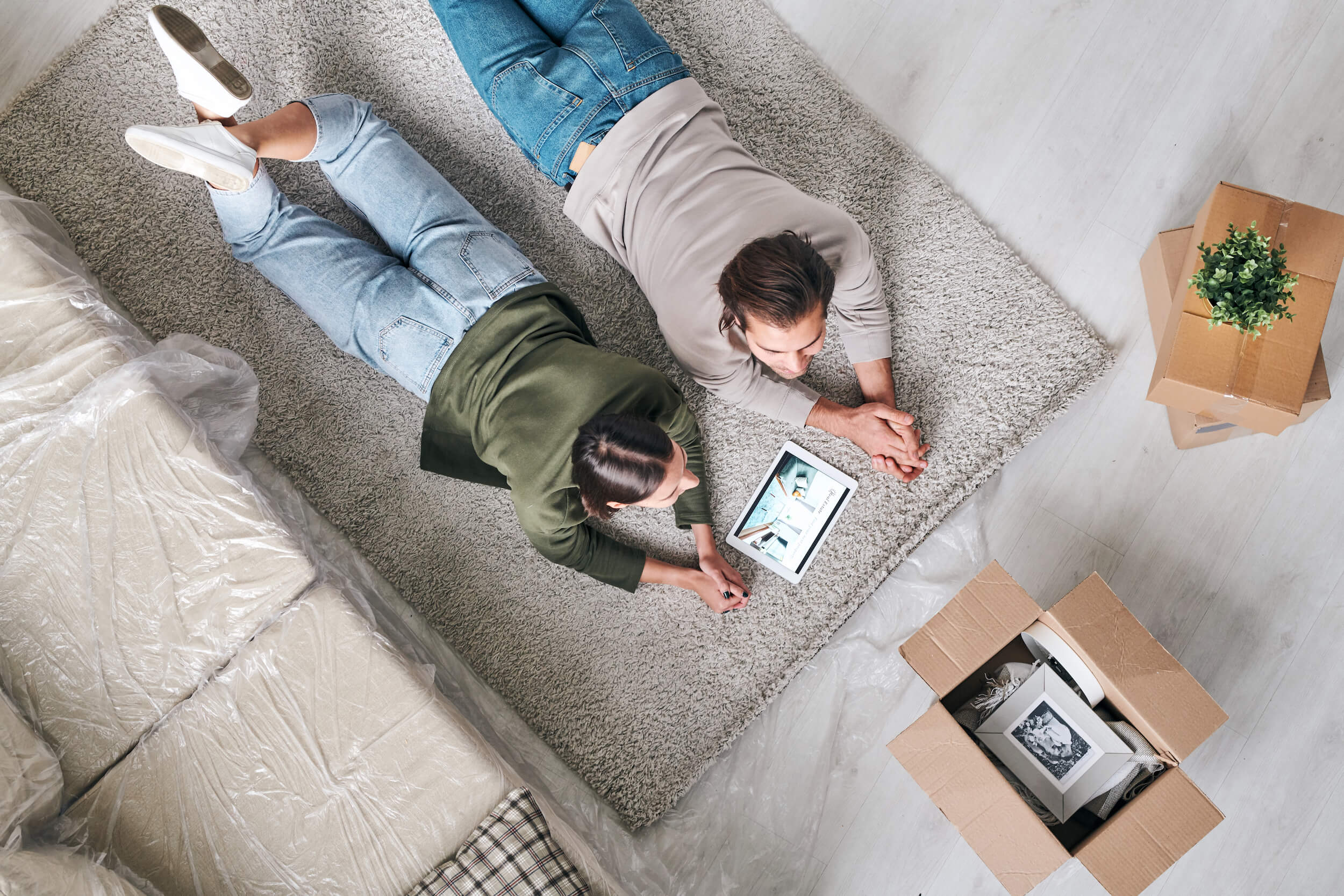 couple laying on rug pads hickory nc
